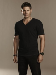 Basic black V-neck T. Great to wear on it's own with some accessories or perfect for layering.