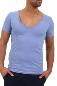 Deep V-neck Tee. This shirt is too tight. It accentuates his out-of-shape chest and you can see nipples (Big No, No). It shows his fat-tire/love handles around his waist. There are pull lines around his stomach, which makes the fat on his stomach stand out. It is too tight on his arms as well. Very unflattering.