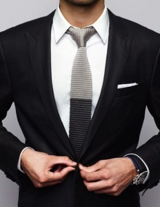 Black suit. You should have a nice suit in your closet. Suits can be very flattering as long as they fit right. The tie shown here is fashion forward and shows you have a modern sense of style.